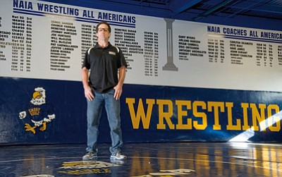 Les Stukenberg/The Daily Courier<br>ERAU assistant wrestling coach Donnie Stevens was recently inducted into his college's University of Southern Illinois-Edwardsville Wrestling Hall of Fame.