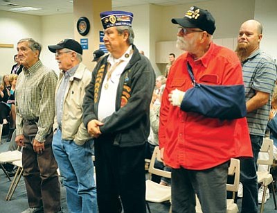Les Stukenberg/The Daily Courier<br>Purple Heart recipients, from left, Frank Schleicher (World War II), James Clark (World War II), Richard Acosta (Vietnam), Ray Curran (Vietnam) and Barret Walters (Iraq) are honored during the Yavapai County Board of Supervisors meeting Monday, April 6, in Prescott.