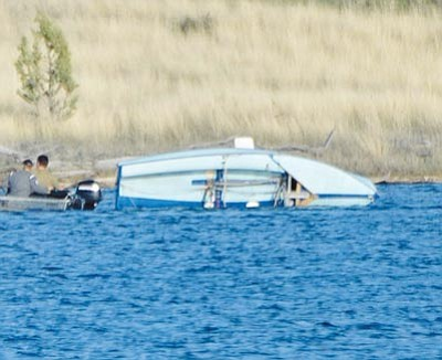 Matt Hinshaw/The Daily Courier<br>Rescuers head to a sailboat that flipped over on Watson Lake.