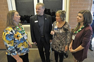 Matt Hinshaw/The Daily Courier<br>Sandy and Perry Massie, middle, talk with scholarship recipients Jennifer Kelly, left, and Jenna Bourque Saturday morning during the Yavapai College Foundation Scholarship Reception at YC in Prescott.  The Massie's are major contributors for the Big Brothers Big Sisters Scholarship fund.