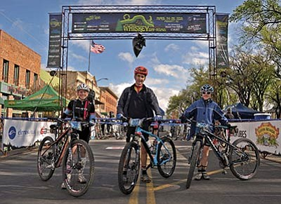 Matt Hinshaw/The Daily Courier<br>From left, Alex Shumaker, 15, Andrew Mull, 16, and Drew Shumaker, 15, members of the Thin Air Junior Racing team, prepare to hit the course for the Whiskey Off-Road 30 Proof at the starting line Saturday morning in downtown Prescott.
