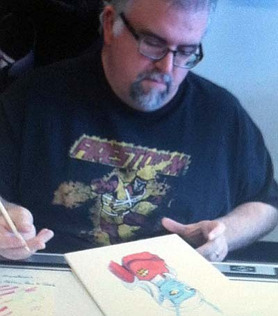 "By Jason Wheeler<br /><br /><!-- 1upcrlf2 -->Dave Beaty works on a sketch of Camari, a character from ""Red Skirts."""