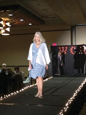 Jason Wheeler/The Daily Courier<br /><br /><!-- 1upcrlf2 -->Century 21's Barbara Phillips walks down the runway.