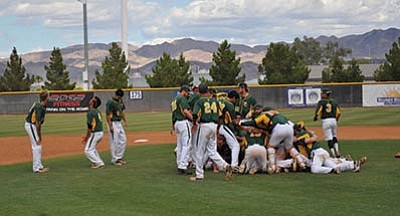 Brad Clifford/Courtesy<Br>The Roughriders storm the field to celebrate Saturday afternoon in Henderson, Nevada, after clinching the Western District Championship.