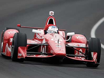 Sam Riche/The AP<br> Scott Dixon, of New Zealand, drives through the first turn during practice before qualifications for the Indianapolis 500 auto race at Indianapolis Motor Speedway in Indianapolis, Sunday, May 17.