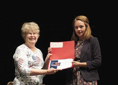 Les Bowen/The Daily Courier<br>Lois Cyr, with American Legion Auxiliary Unit 6, presents one of several awards to Autumn Dominguez on Thursday night at the Prescott High School scholarship awards program.