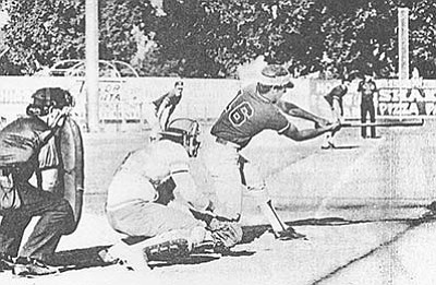 Courier file<br>Dave Holliday strokes a base hit during the Roughriders' 1975 run in Grand Junction.