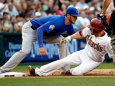 Matt York/The AP<br> Arizona Diamondbacks' A.J. Pollock slides safely into third with a triple as Chicago Cubs' Kris Bryant makes the late tag during the first inning of a baseball game, Friday, May 22, in Phoenix.