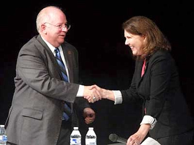 AP file photo<br> Democratic incumbent Ann Kirkpatrick, right, and Republican challenger Andy Tobin shake hands following a Congressional District 1 debate on Oct. 14, 2014, at Mountain View High School in Tucson.