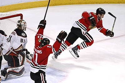 Charles Rex Arbogast/The Associated Press<br>Blackhawks center Andrew Shaw (65) celebrates his goal with Andrew Desjardins during Wednesday's third period in Game 6 of the Western Conference finals in Chicago.