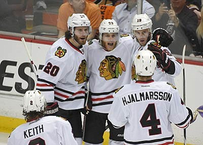 Mark J. Terrill/The Associated Press<Br>The Chicago Blackhawks celebrate center Jonathan Toews's (19) goal against the Ducks Saturday night in Anaheim. The Blackhawks won to advance to their third Stanley Cup Finals this decade.