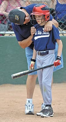 Matt Hinshaw/The Daily Courier<br>Team The Hike Shack's assistant coach Jerry Prieto talks with his batter Zach Cissell while playing against Team Prescott Import Car Service on May 30, 2015, during the Prescott Little League's end-of-season tournament at Bill Vallely Field.