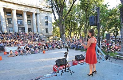 "Taya Jones of Prescott sings ""Georgia on My Mind"" by Ray Charles during the first performance of the 5th annual Prescott Idol at the courthouse plaza in downtown Prescott."