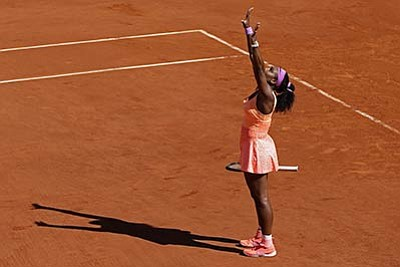 Thibault Camus/The Associated Press<br>Serena Williams celebrates winning the French Open against Lucie Safarova in three sets, 6-3, 6-7, 6-2 Saturday in Paris.