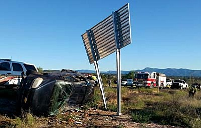 Courtesy photos<br> Traffic backs up Sunday behind a rollover accident on I-17 at MP 295. A non-involved woman was killed when struck attempting to help the rollover victims.