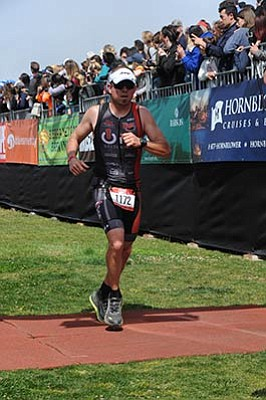 Spin Communications/Courtesy<br>Dan Carroll sprints to the finish line at the Escape From Alcatraz Marathon this past Sunday, June 7, in San Francisco.