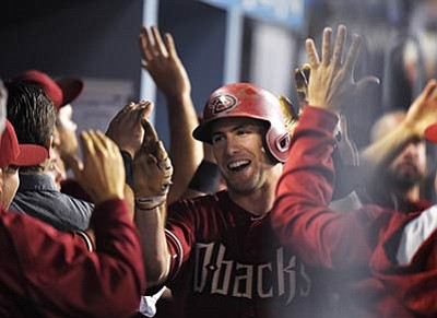 Mark J. Terrill/The Associated Press<br>Paul Goldschmidt is The Man when he returned to the dugout after hitting a two-run home run during Wednesday night's fifth inning in Los Angeles.