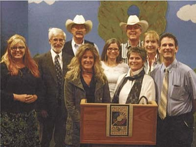 Pictured in the back row are (L to R): Tina Blake (Chalk It Up!), Dana Wingate (Chaparral Music Fest), Jim Buchanan (Arizona Cowboy Gathering), Allison Dixon (Chaparral Music Fest), Joe Konkel (Arizona Cowboy Gathering), Kelly Cassidy (Mountain Artists Guild). Front Row (L to R): Jen Chandler (Prescott College Gallery), Patti Ortiz ('Tis Gallery), Jon Meyer (Prescott Center for the Arts). The awards were: Prescott Center for the Arts $4550; Arizona Cowboy Gathering $4250; Chalk It Up! $3850; Chaparral Music Fest $3800; Prescott College Gallery $3700; 'Tis Gallery $3700; and Mountain Artists Guild $3650.
