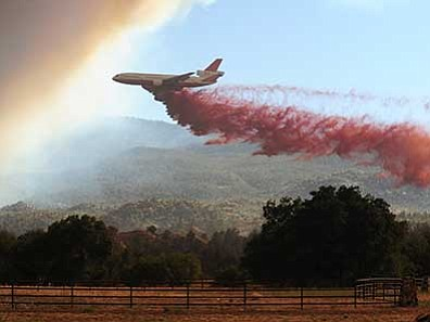 A DC10 heavy air tanker drops retardent along the  eastern side of Granite Mountain near American Ranch as the Doce Fire backs down Granite Mountain in June 2013. (Les Stukenberg/The Daily Courier, file)