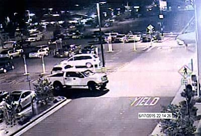 An surveillance camera image shows the truck police believe dropped off the males suspect and driven by a blonde female.