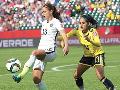 Jason Franson/The Canadian Press via AP<br> United States' Alex Morgan kicks the ball in front of Colombia's Angela Clavijo, during their Women's World Cup round 16 soccer game Monday, June 22.