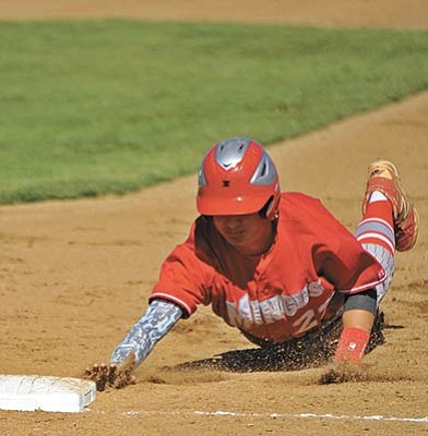 Matt Hinshaw/The Daily Courier, file<br>Tom McCarty of Mingus safely dives back into first base back on April 29 at Prescott High School.