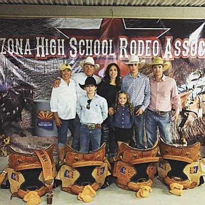 Courtesy photo<br /><br /><!-- 1upcrlf2 -->J.C. Mortensen, 14, of Chino Valley won four junior high state championships in the rough stock events in May, which qualified him for the junior high nationals in June in Des Moines, Iowa. In this photo from the state championships, J.C. is pictured with his family and grandparents with the saddles he won for each state title.<br /><br /><!-- 1upcrlf2 -->