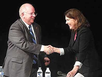 AP file photo<br> Ann Kirkpatrick, right, and Andy Tobin shake hands after a Congressional District 1 debate on Oct. 14, 2014, at Mountain View High School in Tucson.