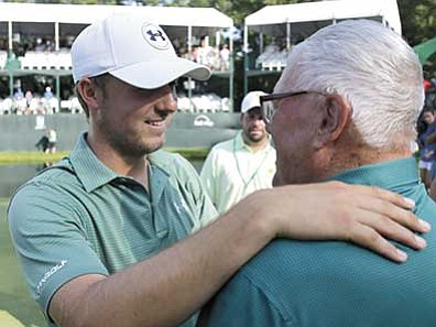 Charles Rex Arbogast/The AP<br> Jordan Spieth, left, celebrates with his grandfather Bob Julius after Spieth won the John Deere Classic golf tournament defeating Tom Gillis on the second playoff hole Sunday, July 12, in Silvis, Ill.