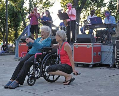 """Matt Hinshaw/The Daily Courier<br>Jeff Weisel and the Cool Azul Band sing """"Happy Birthday"""" to Dorothy Oellers, left, who turned 103 recently, while her daughter Joanne looks on Tuesday evening, July 14, during the Summer Concert Series at the courthouse plaza in downtown Prescott."""