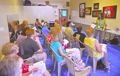 Matt Hinshaw/The Daily Courier<br>Andy Lloyd, owner/trainer of Dandy Dawgs Service Dog Program, talks about the difference between a service dog, assistance dog, and a therapy dog Wednesday evening at Whiskers Barkery in downtown Prescott.