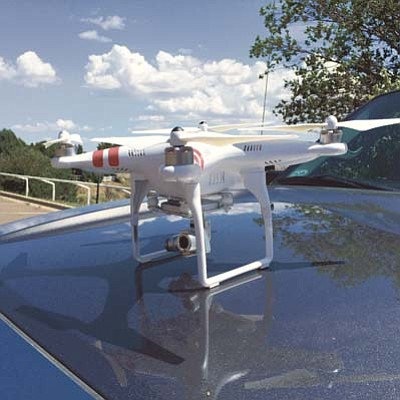 Max Efrein/The Daily Courier<br>Heath Kowacz's dji Phantom 2 Vision drone with a mini 14 megapixel camera runs about $1,000.