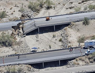 This aerial photo shows the collapsed elevated section of Interstate 10, Monday, July 20, 2015, in Desert Center, Calif. All traffic along one of the major highways connecting California and Arizona was blocked when the bridge over a desert wash collapsed during a major storm. (AP Photo/Matt York)<br /><br /><!-- 1upcrlf2 --><br /><br /><!-- 1upcrlf2 -->
