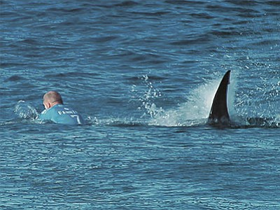 World Surf League via AP<br> Australian surfer Mick Fanning is pursued by a shark, in Jeffreys Bay, South Africa, Sunday, July 19.