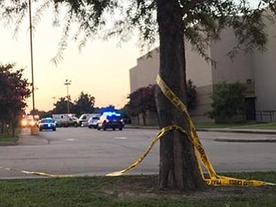 Treylan Arceneaux via AP<br> Police tape surrounds the scene following a shooting at a movie theater Thursday, July 23, in Lafayette, La.