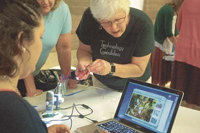 Max Efrein/The Daily Courier<br>Dr. Alice Christie, who coordinated a STEAM workshop for Yavapai County teachers this past week, shows workshop participants how to best operate an electronic microscope.