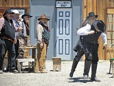 Matt Hinshaw/The Daily Courier<br> Members of the Prescott Regulators and their Shady Ladies reenact a dance and bar scene in Prescott from the late 1800s Saturday afternoon during the 10th annual Shootout on Whiskey Row in downtown Prescott.