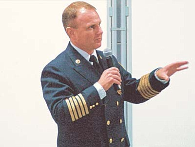 """Scott Orr / Daily Courier<br /><br /><!-- 1upcrlf2 -->Fire Chief Scott Freitag explains the """"fire authority"""" concept that would bring together the Central Yavapai and Chino Valley fire districts at a joint board meeting Wednesday, July 29."""