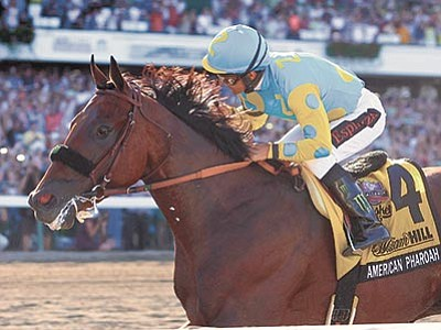 Bill Denver/EQUI-PHOTO via AP<br> American Pharoah, with Victor Espinoza riding, wins the $1,750,000 Grade 1 William Hill Haskell Invitational at Monmouth Park in Oceanport, New Jersey, on Sunday, Aug. 2.