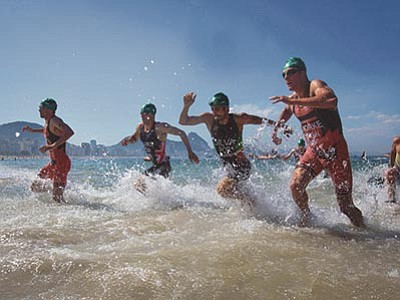 Felipe Dana/The AP<br> Triathletes exit the water during the men's triathlon ITU World Olympic Qualification Event in Rio de Janeiro, Brazil, Sunday, Aug. 2. The World Olympic Qualification is a test event for the Rio 2016 Olympics.