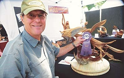 Les Stukenberg/The Daily Courier<br /><br /><!-- 1upcrlf2 -->Wood Whisperings' Bill Daggett of Paradise Valley won Best of Show at the annual Mountain Artist Guild Arts and Crafts Show on the Yavapai County Courthouse Plaza Saturday afternoon. The show continues through Sunday afternoon.<br /><br /><!-- 1upcrlf2 -->