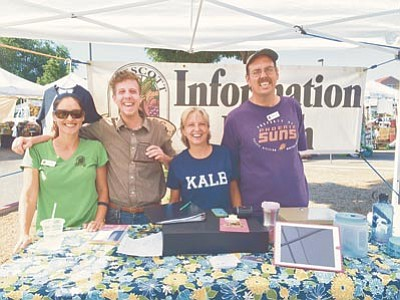 The crew running the Prescott Farmers Market on Saturday, Aug. 8, includes, from left, Lissette Morales, assistant market manager; Willie Heineke, volunteer; Rita Rubin, a member of the Board of Directors; and Randy Goodsell, raffle master. <br /><br /><!-- 1upcrlf2 -->(Photos by Max Efrein/The Daily Courier)