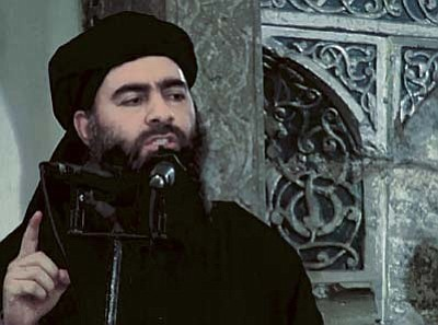 This file image made from video posted on a militant website Saturday, July 5, 2014, which has been authenticated based on its contents and other AP reporting, purports to show the leader of the Islamic State group, Abu Bakr al-Baghdadi, delivering a sermon at a mosque in Iraq during his first public appearance. An online image released Wednesday purported to show the Islamic State affiliate in Egypt had beheaded a Croatian hostage. (AP Photo/Militant video, File)
