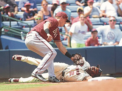 John Bazemore/The AP<br> Atlanta Braves' Michael Bourn is tagged out at third by Diamondbacks third baseman Jake Lamb while attempting to advance on a wild throw to second Sunday, Aug. 16, in Atlanta.