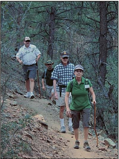 Courtesy<br>Pat Gulley, Highlands Center Naturalist, leads a group on one of the moderate Highlands Center hiking trails.