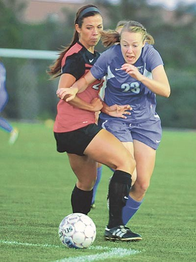 Les Stukenberg/The Daily Courier, file<br> Kalyn Goodenough (23) battles with a defender as the Embry-Riddle Lady Eagles take on the Arizona Christian University Firestorm in the 2014 home opener in Prescott.