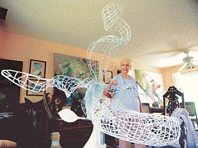 Les Stukenberg/The Daily Courier<br>Yavapai College art student Eleanor Gilbert displays some of her steel welded art sculptures at her Prescott Valley home.