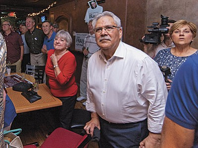 Matt Hinshaw/The Daily Courier<br> Mayoral Candidate Dan Fraijo looks on as the first round of results come out Tuesday night at Brick and Bones Moonshine Bar and Bistro in downtown Prescott.