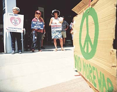 Les Stukenberg/The Daily Courier<br>Approximately 30 people gather outside the Prescott offices of Rep. Paul Gosar and Sen. John McCain to encourage them to support the proposed Iran arms agreement.