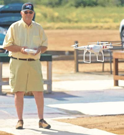 Matt Hinshaw/The Daily Courier<br>Jack Hardy a member of the Casa de Aero Radio Control Club flies his DJI Phantom multirotor Thursday morning during open flying at the club field in Prescott.